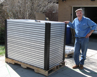Bill with stack of 200W panels