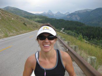 "Mindy climbing up the ""road section"" with the beautiful tetons in the background."