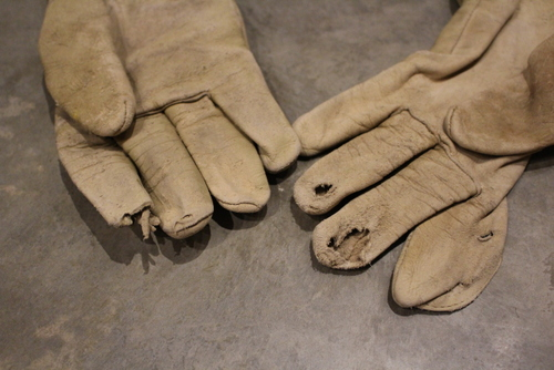 Holes in leather work gloves.