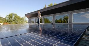 Me next to my solar array .  Photo Credit : Salt Lake Tribune